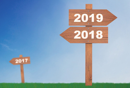 New year concept background, wooden sign 2018 and 2019 on blue sky, future ahead Stok Fotoğraf
