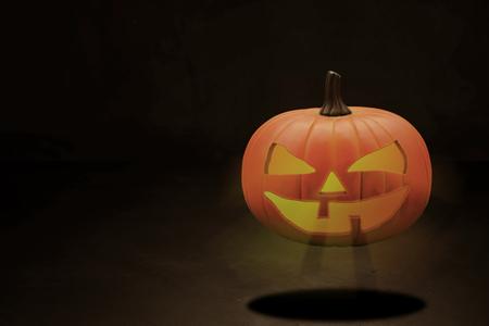 Halloween pumpkin head on dark tone background, copy space
