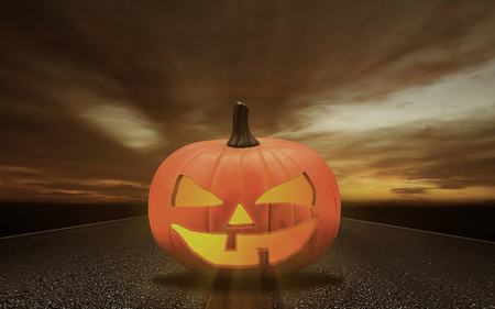 Halloween pumpkin head on dark tone road background, copy space Stok Fotoğraf
