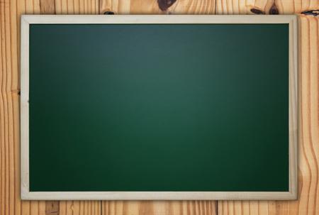 Blackboard, chalkboard on wooden background, education concept, vintage and retro