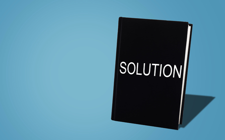 Business solution, solving problem, strategy and planning concept, black book on blue background