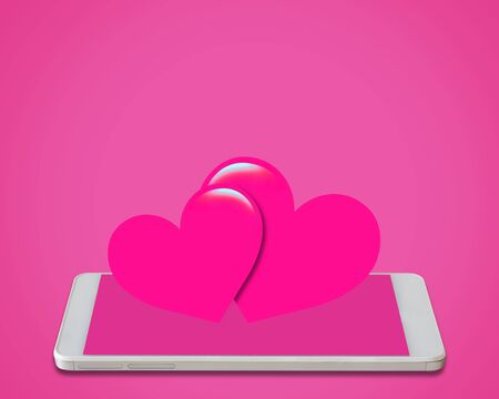 pink heart on mobile phone, love, valentine day and wedding concept, internet dating Stok Fotoğraf