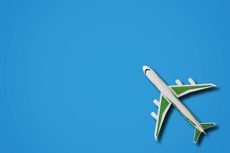 Travel concept, airplane on blue