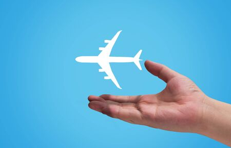 Travel concept, airplane and hand on blue background Stok Fotoğraf