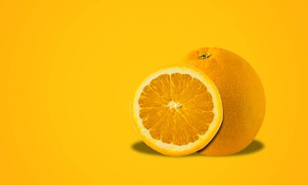 Fresh orange on orange background, fruit concept