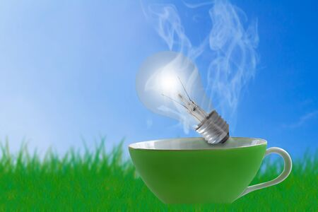 Creative idea concept, light bulb and coffee cup on blue sky background Stok Fotoğraf