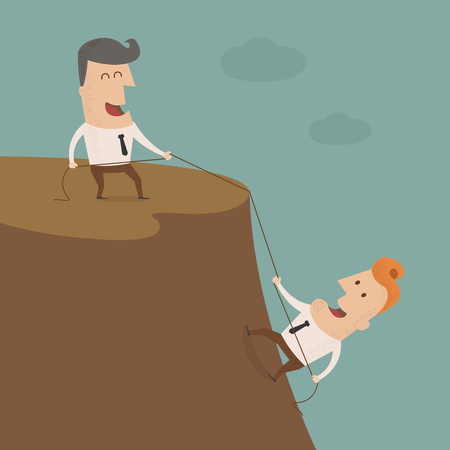 Businessman on the top of a rock helping another businessman to climb up