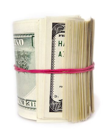 Bunch of hundred dollars with red elastic band. photo