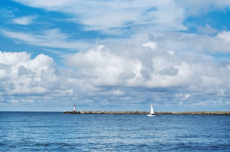 Sailing ship going to the open sea. Stock Photo - 9367436