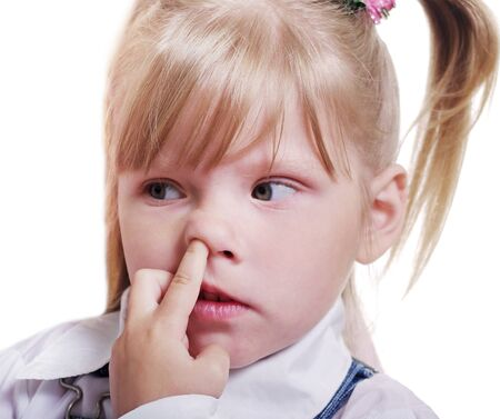 nostril: The small girl is puting her finger into nostril.