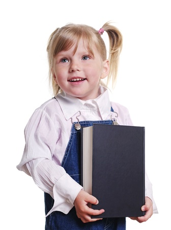 Small girl keeping the big book in her hands. photo