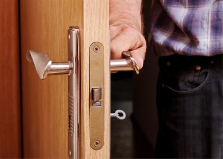 room access: Man open the door, horizontal photo.