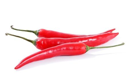 Drie rode paprika's op de witte surfase. Stockfoto