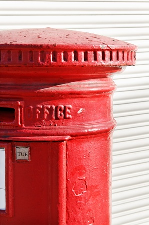 Part of a red postbox in the London. photo