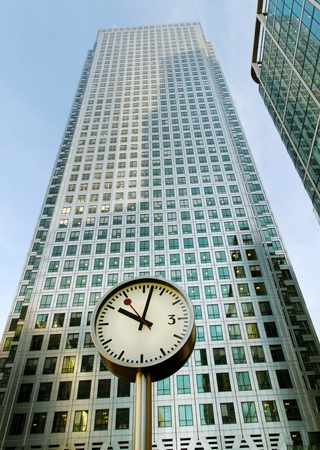 Clock on the skyscraper background.  photo