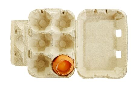 One broken egg in a box, isolated on white surface. photo