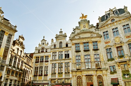 blue facades sky: Brussels grand place building with gold ornate.