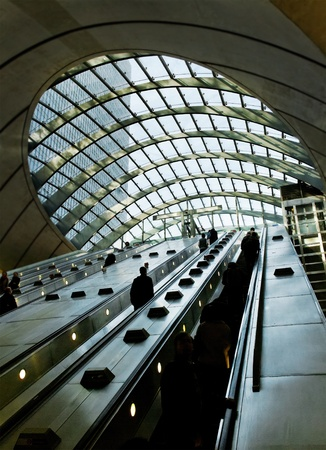 Silhouette of passengers on an escalator. Editorial
