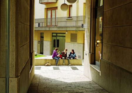 Italian pupils on sunny courtyard eating icecream  photo