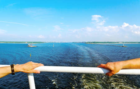 banister: Two men hands on ship banister in cruise time  Stock Photo