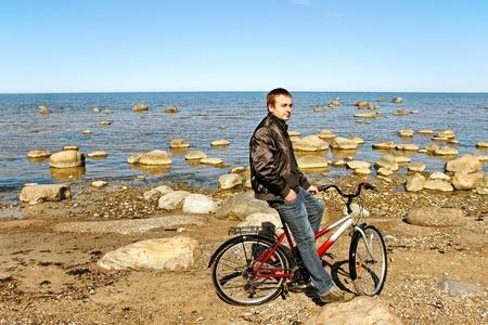 Man with bike at sea  photo