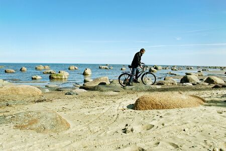Man with bike on the beach  photo