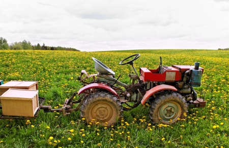 Old traktor with trailer on a field  photo