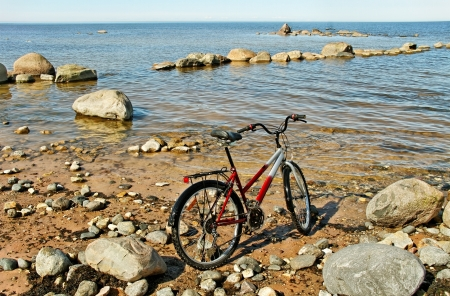 Bike on stone beach at the sea  photo