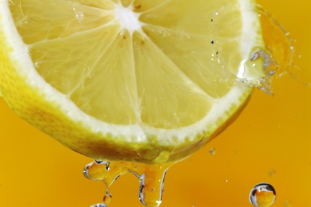 stream water: Yellow lemon with water drops