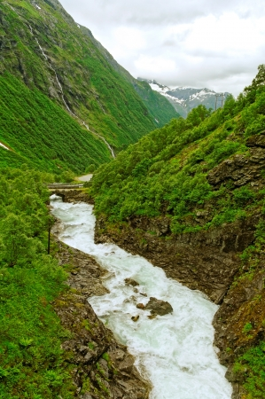 Mountain river and waterfall in the Norway  photo