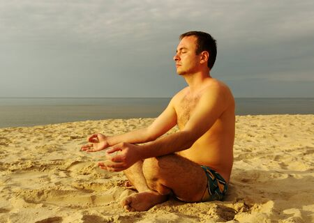 Man meditating in lotus position  photo