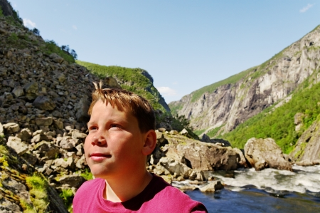 Boy look around to the mountains in Norway  photo