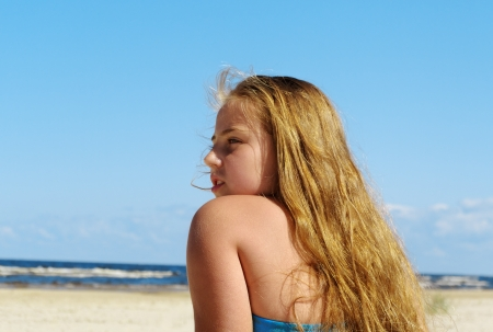 Girl relax on the beach in a summer day  photo