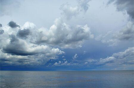season specific: Cloudscape above Baltic sea, season specific  Stock Photo