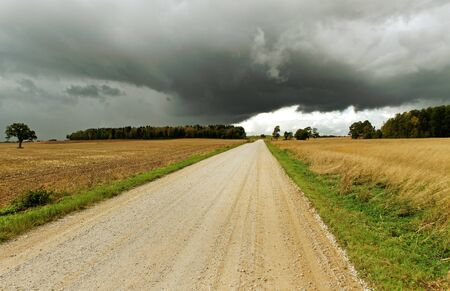 Country road and stormy clouds  photo
