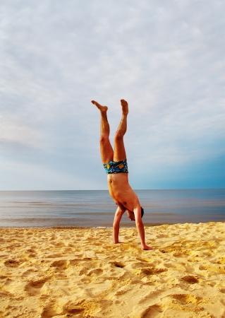 Athletic man at the sea  photo