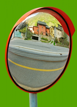 convex: Natural security mirror isolated on green surface  Stock Photo
