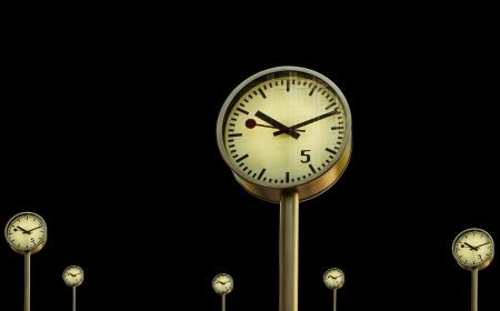 canary wharf: Clocks in Canary Wharf in London