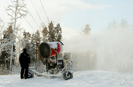 Worker control snow making tool on the skiiing hill  Stock Photo - 16322987