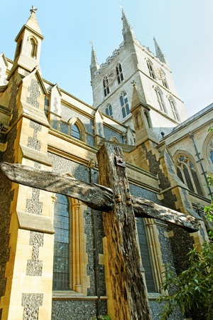 The Southwark Cathedral church with wodden cross in London  photo