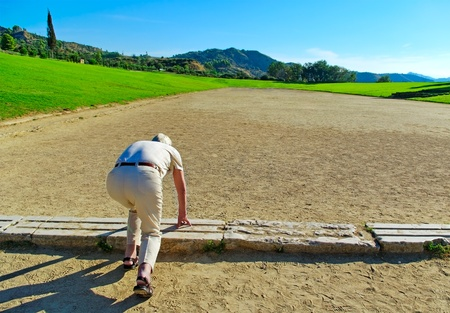 Adult man in making start on stadium in Olympia, Greece Stock Photo - 18533355