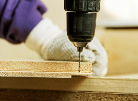 power tools: Working carpenter with drill  Stock Photo