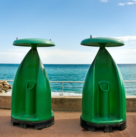 Two toilets outside at the sea  photo