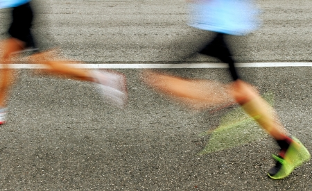 Blur of running people on the asphalt  Standard-Bild