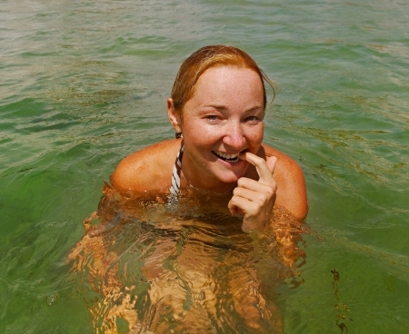 Young woman is swimming in Black sea. photo