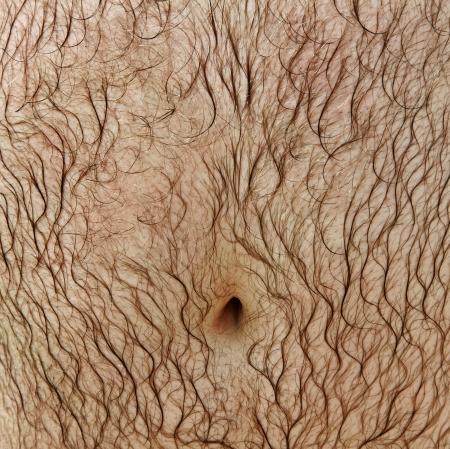 Wet man stomach after shower.