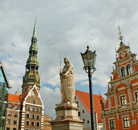 The statue of Roland and House of Blackheads and Church of St. Peter in the centre of Riga. Stock Photo