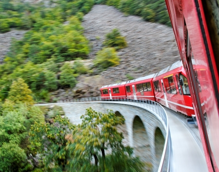 Red train from Tirano to the Switzerland. Stock Photo