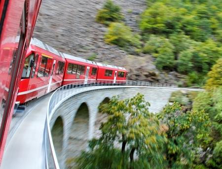 Red train from Tirano to the Switzerland. Stock Photo