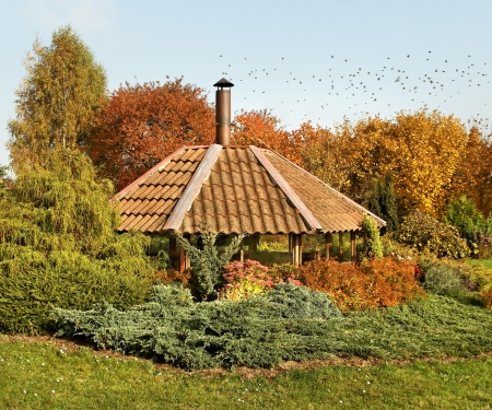 Arbor with campfire in an autumn season.